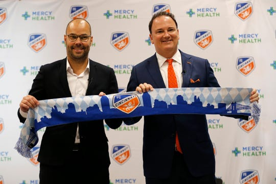 FC Cincinnati general manager Gerard Nijkamp (left) and team president Jeff Berding pose for a photo after a press conference to introduce the team's new general manager at the FC Cincinnati practice facility in Milford, Ohio, on Thursday, May 30, 2019. FC Cincinnati announced team president Jeff Berding would be stepping away from soccer operations to make way for the new GM.