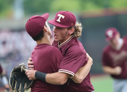 Turpin player Justin Silverstein, right,  celebrates during the Spartans' win in the regional semifinal against Vandalia Butler, Thursday, May 30, 2019.