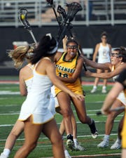 Sycamore's Maddy Davis looks to score in the Division I lacrosse state semifinals at Beavercreek High School.