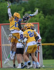 Mariemont player Josh McClorey (13) and midfielder Bates Gall celebrate  after a goal during their state semifinal against Columbus DeSales, Wednesday, May 29, 2019.