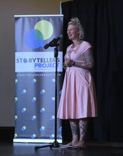 At the Cincinnati Storytellers Project show May 29, Molly Wellmann, Cincinnati's master mixologist, tells a story of how her tattoos are a diary of her life. The show was at the Transept in Over-the-Rhine.