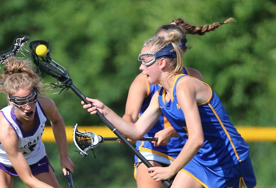 Mariemont player Marley Megowen picks up the ball during their state semifinal against Columbus DeSales, Wednesday, May 29, 2019.
