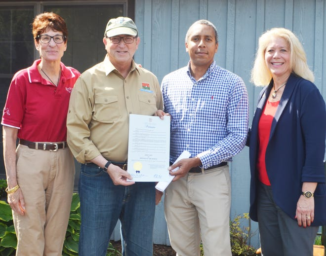 New Jersey Secretary of Agriculture Douglas H. Fisher (second from left)presenting the Month of the Horse proclamation from Gov. PhilMurphy to Mid-Atlantic Equine Medical Center President Dr. Rodney Belgrave with Rutgers Equine Science Center Founding Director Dr. Karyn Malinowski on the left and Hunterdon County Freeholder Susan Soloway on the right.