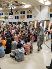Military personnel from Joint Base McGuire-Fort Dix greet Memorial Elementary School children during a school-wide assembly