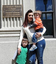 Amanda Wright of West Lafayette with her children Axel Connell, 3, and Dawson Connell, 2, outside Coshocton County Probate and Juvenile Court. She also has Remi Connell, 4, and Kamdin Lewis, 9. If it was not for the family drug court program, Wright could have lost custody of her children due to a prescription drug problem.
