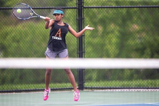 Ames' Arunadee Fernando returns a shot during the Class 2A girls' tennis state championship, Thursday, May 30, 2019, at Bettendorf High School in Bettendorf, Iowa.