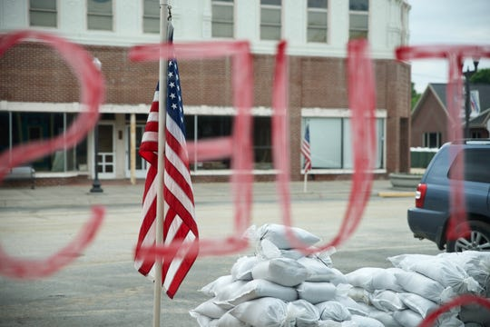 Sandbags are seen outside Stoner Drug Co. in Hamburg, Iowa on May 30, 2019. Stoner Drug, which reopened two days prior, is one of fewer than 10 businesses currently open in Hamburg.