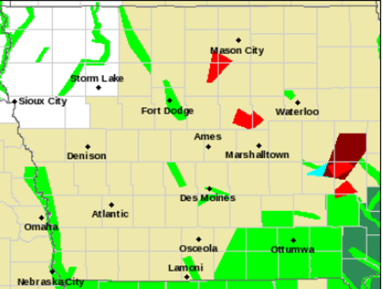A National Weather Service graphic at 8:30 p.m. Wednesday depicts storm warnings across Iowa. Dark red and green shading signifies flooding concerns while lighter green shading represents areas with tornado warnings.