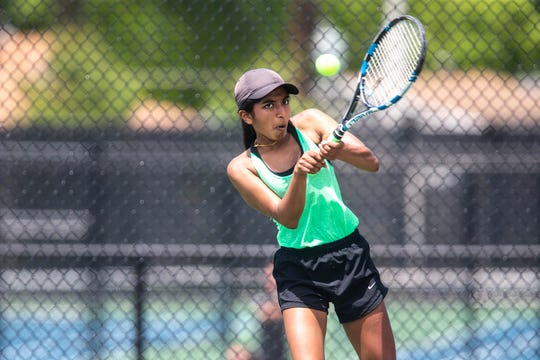 Iowa City West's Jessica Moonjely returns a shot while competing in doubles during the Class 2A girls' tennis state championship, Thursday, May 30, 2019, at Bettendorf High School in Bettendorf, Iowa.