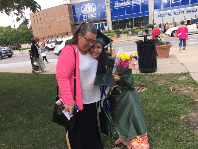 Hoover graduate Khine Myo Aye Thein poses for a photo with her teacher Jillea Bueso outside the Knapp Center.