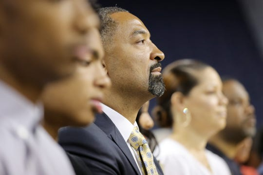 Juwan Howard sits in the audiences as he waits to be introduced by University of Michigan athletic director Warde Manual as the new head basketball coach during a press conference on Thursday, May 30, 2019 at Crisler Center in Ann Arbor, Mich.
