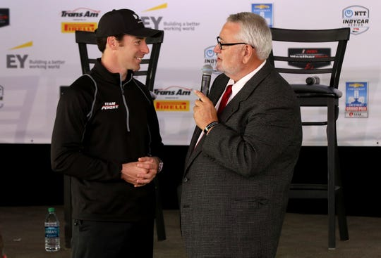 Simon Pagenaud, the 2019 Indianapolis 500 winner, talks with radio announcer Larry Henry during the IndyCar media luncheon at The Roostertail in Detroit, Michigan on Thursday, May 30, 2019.
