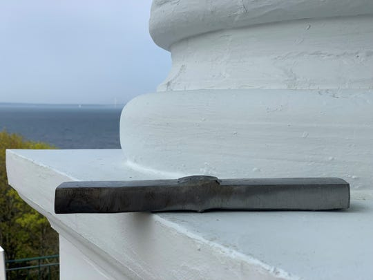 A section from the on-shore portion of Line 5, removed during routine maintenance, according to an Enbridge official, with the Straits of Mackinac through which portions of the pipeline run in the background. Photographed on the porch of the Grand Hotel on Mackinac Island on May 30, 2019.