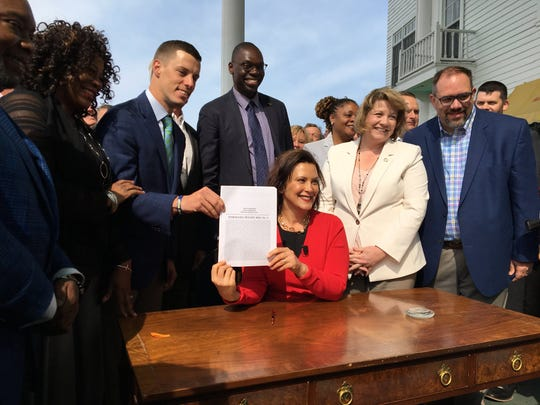 Michigan Gov. Gretchen Whitmer shortly after signing the new auto insurance bill into law May 30, 2019, at the Mackinac Policy Conference.