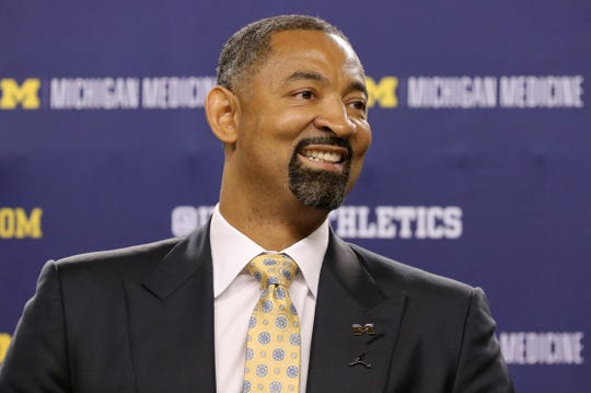 Juwan Howard smiles at the podium after being introduced as the new head coach of the Michigan men's basketball team Thursday, May 30, 2019 at Crisler Center in Ann Arbor.