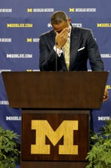 Juwan Howard becomes emotional as he stands at the podium after being introduced as the new head coach of the Michigan men's basketball team during a press conference on Thursday, May 30, 2019 at Crisler Center in Ann Arbor, Mich.