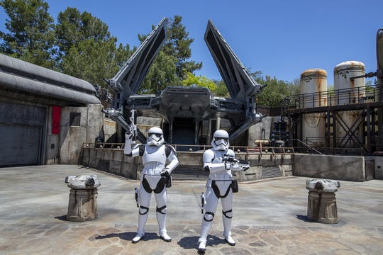 Storm Troopers patrol The First Order Outpost where the Tie Echelon fighter ship is parked as media members get a preview during the Star Wars: Galaxy's Edge Media Preview event at the Disneyland Resort in Anaheim, Calif., on May 29, 2019. (Allen J. Schaben/Los Angeles Times/TNS)