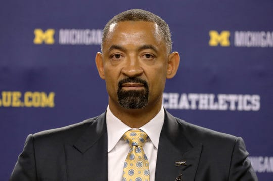 Juwan Howard stands at the podium after being introduced as the new head coach of the Michigan men's basketball team during a press conference on Thursday, May 30, 2019 at Crisler Center in Ann Arbor, Mich.