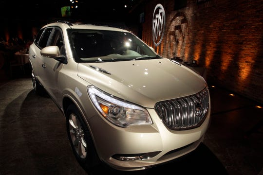 The 2013 Buick Enclave is unveiled at a news conference ahead of the New York International Car Show, Tuesday, April 3, 2012 in New York.  (AP Photo/Mary Altaffer)