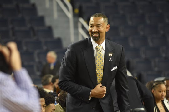 Juwan Howard enters his press conference Thursday.