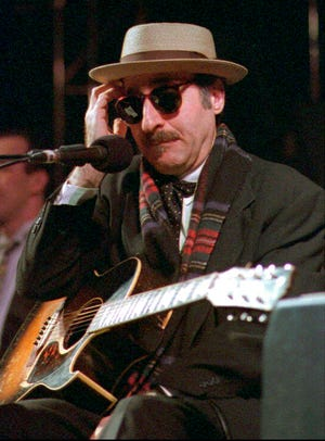 This March 28, 1998 file photo shows Leon Redbone performing in Eureka, Calif. Redbone, the acclaimed singer and guitarist who performed jazz, ragtime and Tin Pan Alley-styled songs, died Thursday, May 30, 2019, according to a statement released by his family.