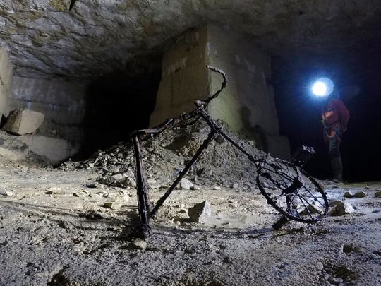 In this photo taken on Friday May 17, 2019, a childs bicycle quietly rusts in a quarry in Fleury-sur-Orne, near Caen, Normandy.