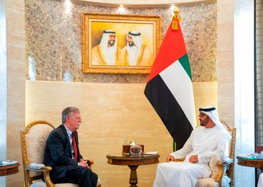 In this Wednesday, May 29, 2019, photo made available by Emirates News Agency, WAM, Sheikh Mohammed bin Zayed Al Nahyan, crown prince of Abu Dhabi and Deputy Supreme Commander of the UAE Armed Forces, right, talks with the U.S. National Security Adviser John Bolton in Abu Dhabi, United Arab Emirates.