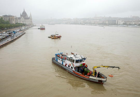 A rescue ship at Margaret Bridge during a search operation on the River Danube in Budapest, Hungary, Thursday, May 30, 2019, following a collision of a hotel ship and a smaller cruise ship on the previous evening.
