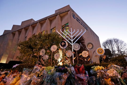 In this Sunday, Dec. 2, 2018 file photo, a menorah is installed outside the Tree of Life Synagogue in preparation for a celebration service at sundown on the first night of Hanukkah, in the Squirrel Hill neighborhood of Pittsburgh.