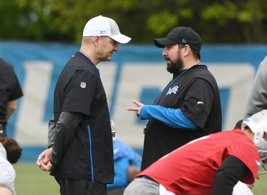 Lions offensive coordinator Darrell Bevell and head coach Matt Patricia talk on the field during warmups during OTAs on May 21 in Allen Park.