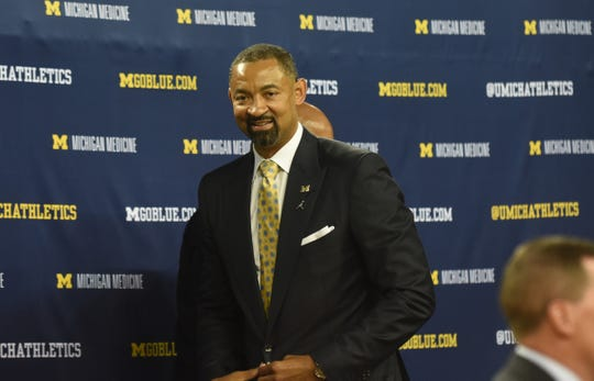 Juwan Howard walks off the stage after speaking to the news media at the Crisler Center in Ann Arbor