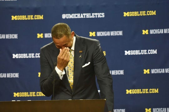Juwan Howard gets emotional as he is introduced as Michigan coach.