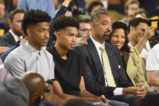 New University of Michigan men's basketball coach Juwan Howard is already emotional with anticipation as her waits to be introduced to the crowd inside Crisler Center while sitting with his sons (from left) Jace and Jett Howard and his wife Jenine Howard in Ann Arbor on Thursday, May 30, 2019.
