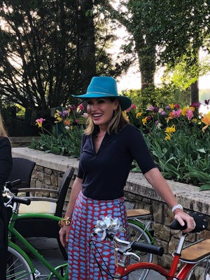 Danialle Karmanos gives her board members new custom bicycles.
