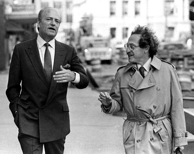 In this April 29, 1985 file photo, Claus von Bulow, left, walks with his defense attorney Alan Dershowitz. Von Bulow, who was convicted but later acquitted of trying to kill his wealthy wife in two trials that drew intense international attention in the 1980s, died Saturday, May 25, 2019  in London, said his son Riccardo Pavoncelli. He was 92.