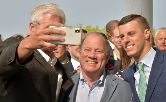 Detroit Mayor Mike Duggan poses for a selfie with Senate Majority Leader Mike Shirkey, left, R-Clarklake, and Speaker of the House Lee Chatfield, right, R-Levering, Thursday at the Mackinac Policy Conference.