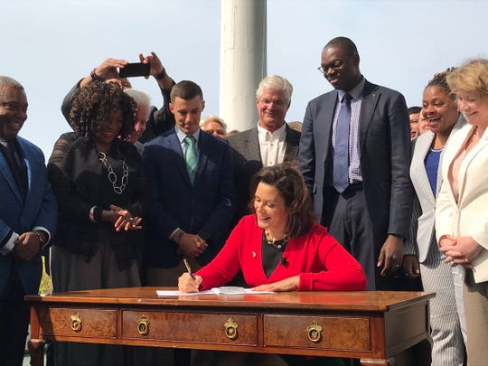 Gov. Gretchen Whitmer signs historic no-fault auto insurance reform legislation.