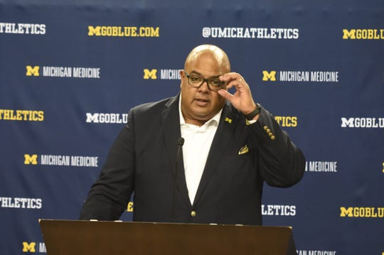 Michigan athletic director Warde Manuel says new head coach Juwan Howard wasn't hired to reunite the Fab Five, or raise their banners.