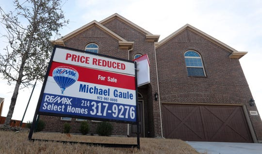 In this Wednesday, Feb. 20, 2019, photo a price reduced for sale sign sit in front of a home in north Dallas.