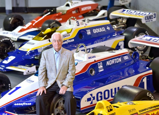 Roger Penske, Team Penske owner and chairman of Penske Corp., sits among four of 18 Indy 500 winning Indy Car Series vehicles during a tour of his Penske Restoration building in southeast Michigan.