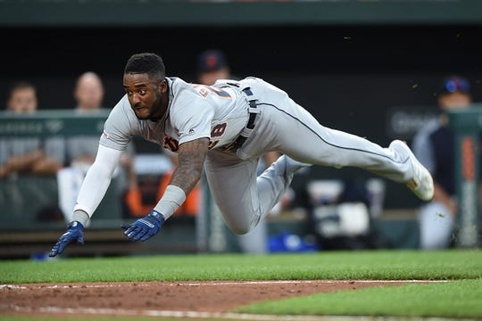 The Detroit Tigers Niko Goodrum dives for home plate on a double by Nick Castellanos in the fourth inning.