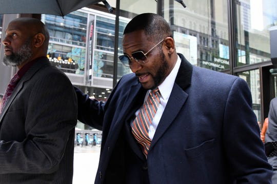 Musician R. Kelly leaves the Daley Center after a hearing in his child support case on Wednesday, May 8, 2019, in Chicago.