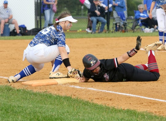 Jasmine Cook of Elmira safely dives back into first base as Horseheads first baseman Tess Cites makes the tag during a Section 4 Class AA softball semifinal May 29, 2019 at Horseheads Middle School.