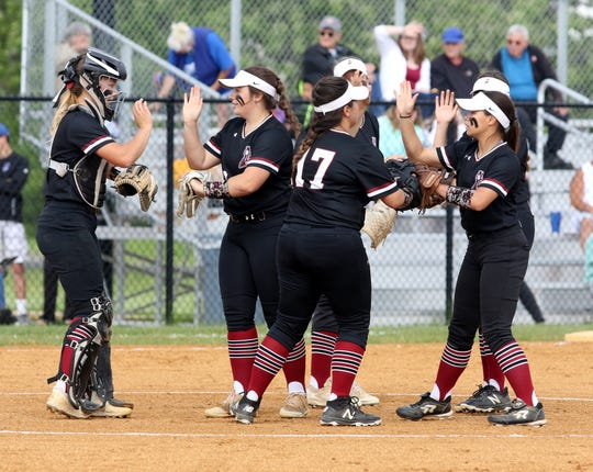 Elmira players high-five each other at the pitcher's mound during a 9-1 win over Horseheads in a Section 4 Class AA softball semifinal May 29, 2019 at Horseheads Middle School.