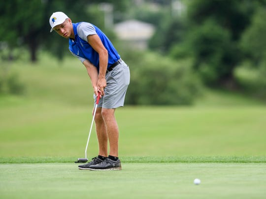 Castle's Adam Bratton putts on the ninth hole green during the IHSAA boys golf sectional at Helfrich Hills Golf Course in Evansville, Ind., Thursday, May 30, 2019. He shot 4-under 67 with five birdies to win the individual sectional title.