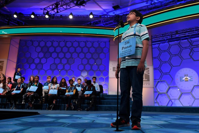 Pranav Chandar, 11, of Newburgh, Ind., competes in the finals of the Scripps National Spelling Bee in Oxon Hill, Md., Thursday, May 30, 2019. (AP Photo/Susan Walsh)