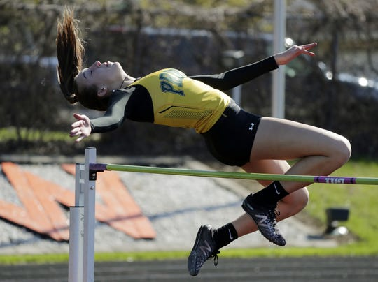 Green Bay Preble's Carley Duffney competes in the high jump earlier this month. She qualified for the state track and field meet in the 100 and 300 hurdles.