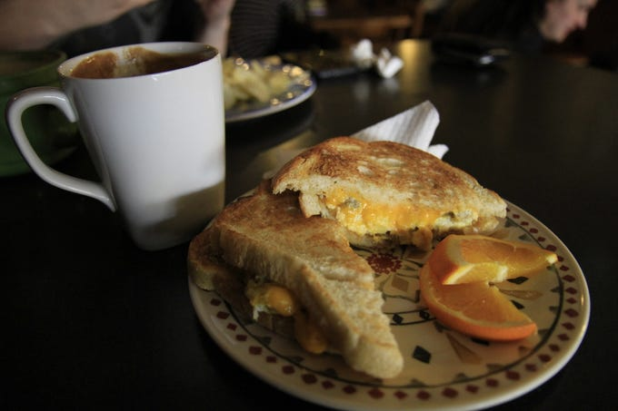 Sausage, egg and cheese breakfast sandwich with an almond joy latte at Fire Tower Coffee House.