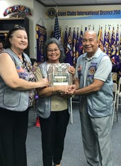 Dot Leon Guerrero, center, was recognized by Lions Club International as a Melvin Jones Fellow with a special plaque and pin for her donation of $1000 to the Lions Club International Foundation through the Melvin Jones Fellowship Program. Donations from Melvin Jones Fellows provide 75% of the foundation's annual revenue which addresses needs in areas such as disaster relief, hunger relief, vision programs, environment, and pediatric cancer, among others. The presentation was held on May 21. Pictured: Doris Cruz, LCIF coordinator, Leon Guerrero, and President Pete Babauta.