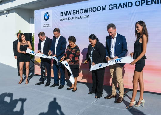 A ribbon cutting is held to celebrate the official opening of the new BMW showroom at the Atkins Kroll dealership in Tamuning on Wednesday, May 29, 2019. Cutting the ribbon, from left: George Ashford, Asia Inchcape, PLC. CEO; Alex Hammett, Atkins Kroll, Inc. president; Gov. Lou Leon Guerrero; Speaker Tina Muña Barnes and Christopher Wehner, BMW Group Asia managing director.